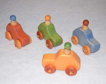 Car, wooden toy, different colors: red, green, blue, yellow.