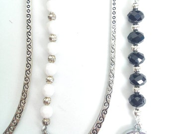 Bookmark with  beads and a silver tone crescent with diamante effect pendant