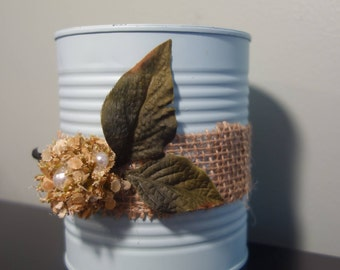 Upcycled tin can with burlap and flower