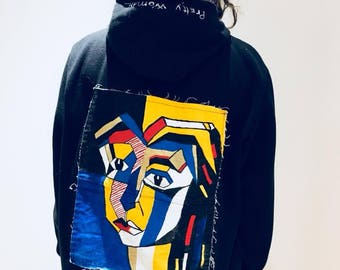 Sweater with hood painted by hand.