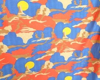Desert Scene Jersey Knit Fabric in Blue, Brown, Yellow, and Red Orange One Yard Yardage