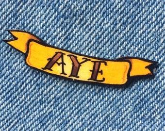 AYE scroll pin badge