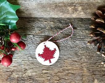 Cross stitch Canadian maple leaf laser cut wood Christmas tree ornament by Canadian Stitchery