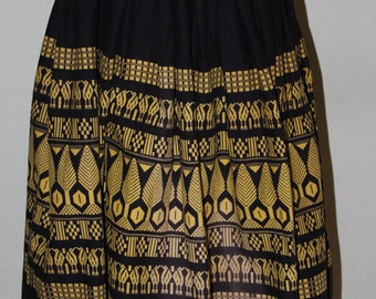 """28"""" waist, classic 1950's vintage circle skirt, black and gold"""