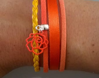 Bracelet with small attached magnet orange