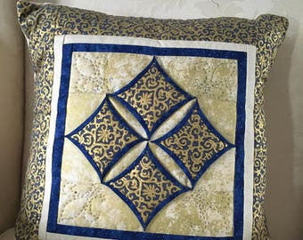 Cathedral window patchwork cushion