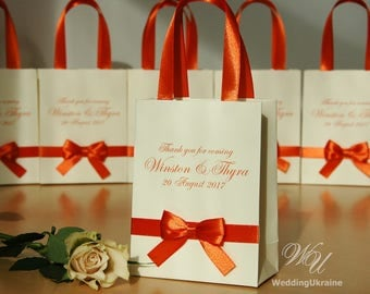 Elegant Ivory Wedding bag Personalized with Orange satin ribbon, bow and custom names - Wedding welcome bags for guests Gifts and favors
