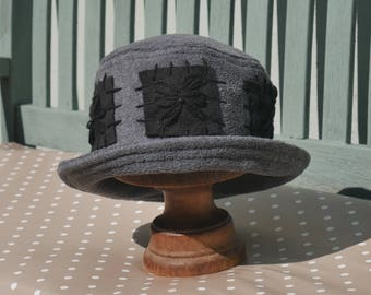 Charcoal grey embroidered daisy cloche fleece hat