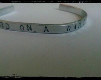 Like a bird on a wire hand stamped cuff bracelet