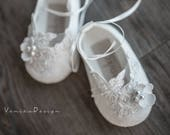 Richly decorated ivory baptism shoes with lace and flower
