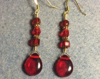 Bright red Czech glass pear drop earrings adorned with bright red Czech glass beads.