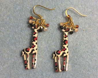 Peach, red, and black spotted enamel giraffe charm earrings adorned with tiny dangling peach, red, and black Chinese crystal beads.