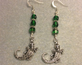 Silver alligator charm dangle earrings adorned with emerald green Czech glass beads.