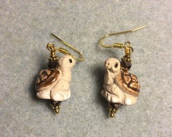 Tan and dark brown ceramic turtle bead earrings adorned with dark brown Chinese crystal beads