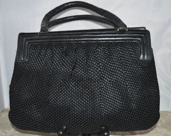Saks Fifth Avenue / black leather / woven fabric / purse / made in Italy / gold clip closure / leather interior /  leather handle / trim