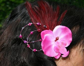 With feathers and Orchid bridal hair ornament