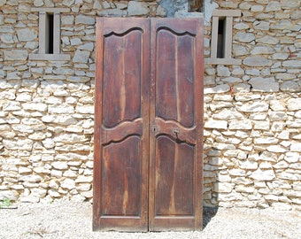 Pair of antique walnut wood French double doors. Good patina on the wood with full locking system.