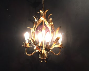 Pretty vintage gilt tole chandelier reed style leaves. 4 branch. Gilt in good vintage condition.  Romantic, french shabby chic