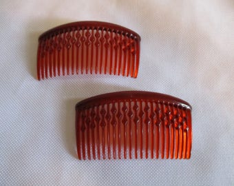 2 Vintage hair combs- amber colored with design