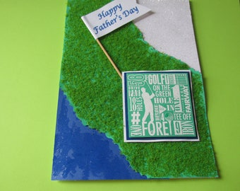 """Golf Fairway Father's Day Card, water, sand, """"Happy Father's Day"""" on the flag."""
