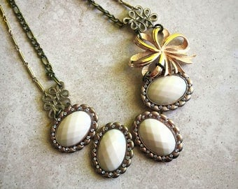 Repurposed gold broach statement necklace with bow pendant