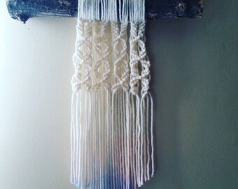 Yarn macreme on a thick tree branch, wall hanging