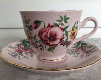 Colclough bone china, pale pink teacup and saucer, gold trim, pink, yellow, purple flowers