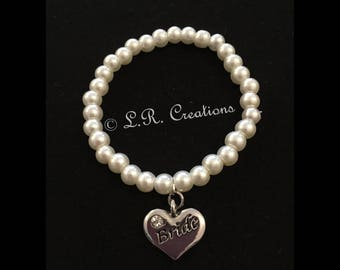 Ivory pearl beaded bracelet with wedding party charm