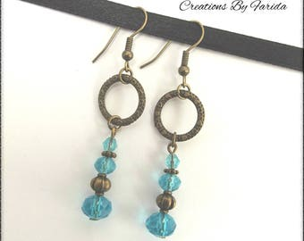 Bronze earrings with turquoise pearls finish