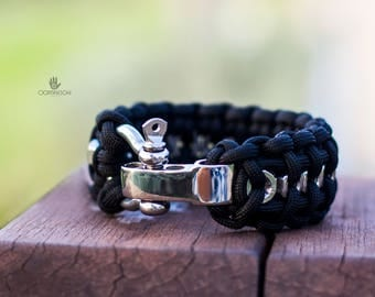 Paracord bracelet with nuts and adjustable clasp.