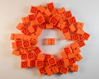 LEGO 2x2 Orange Bricks. Lot of 25. Brand new!