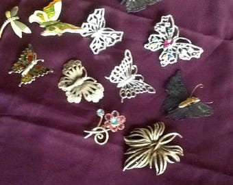 Various decorative pins to wear  very pretty and lots of butterflies