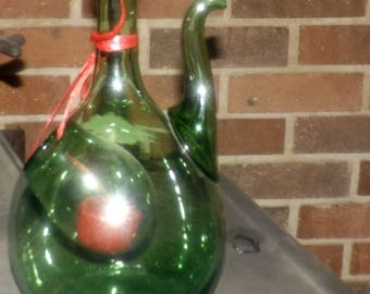 Mid-century (c.1950s) green glass decanter with ice bulb and fiasco stopper.