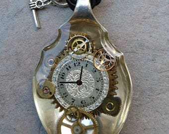 antique EPNS sugar spoon with beautiful engraved silver dial and vintage watch parts set in jewellery grade resin