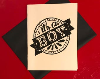 """black and white hand lettered """"it's a boy"""" card"""