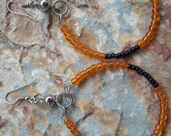 Small hoops,small beaded hoops,small hoop earrings,handmade hoops,black orange hoops,stylish,modern,trendy,fashion,elegant, light,oval,hoops