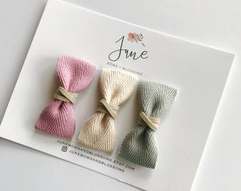 w o v e n  suede wrapped bow, ribbon bow, leather wrapped bow