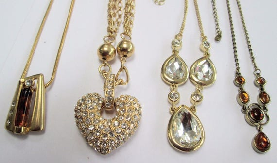 Four good vintage gold metal necklaces amber glass, diamante heart, glass all beautiful
