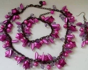 plastic bead necklace, bracelet and earrings
