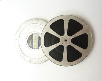 Large metal film reel and tin, vintage movie can and full spool of film. 1959 Scouts