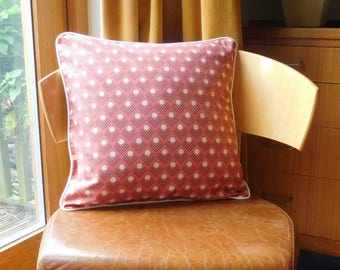 Abstract cushion in red and cream.  Geometric cushion in red and cream. Retro style cushion in red and cream.