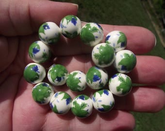 2 green multicolor flower 12MM ceramic beads.