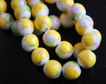 2 CERAMIC YELLOW 10MM FLOWER BEADS.