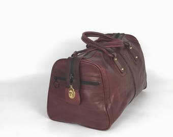 Weekender, travel bag, for travel and fitness burgundy. From full leather, small Manufactory series