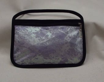 Black cover with fancy mauve and purple fabric