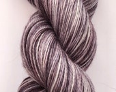 A luxuriously soft hand dyed yarn in shades of grey on a gorgeous bfl, silk and cashmere base.