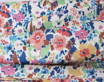 Liberty cotton fabric with multicolored flowers.