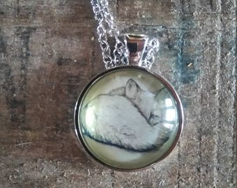 chain and silver color Locket with a Fox sleeping