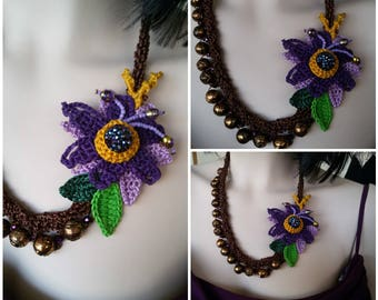 Floral romantic crochet necklace made with yarn candle.