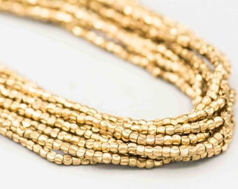 "Crescent Faceted Brass Beads 2x2.2mm 280 on 22"" Strand MCF-B-235"